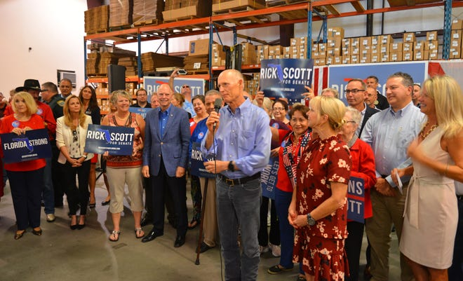Gov. Scott and his wife Ann made campaign stop at Bansbach Easylift in Melbourne early Monday morning, with many other Republicans on hand for the visit urging people to get out and vote Republican.