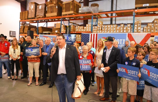 Rep. Randy Fine talked about the importance of calling and knocking on doors the day before Election Day. Gov. Rick Scott and his wife Ann made a campaign stop early Monday morning at Bansbach Easylift, where other Republican politicians  and candidates were on hand to meet him.