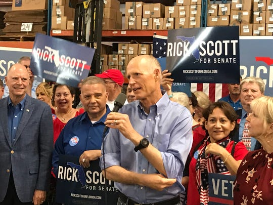 Florida Gov. Rick Scott, at a Melbourne GOP rally at Bansbach Easylift of North America, gets in some final campaign digs at his opponent for the U.S. senate, Democrat incumbent Bill Nelson. To the far left of Scott is U.S. Rep. Bill Posey, R-Rockledge, who also is running for re-election and is being challenged by Democrat newcomer, Sanjay Patel of Satellite Beach.