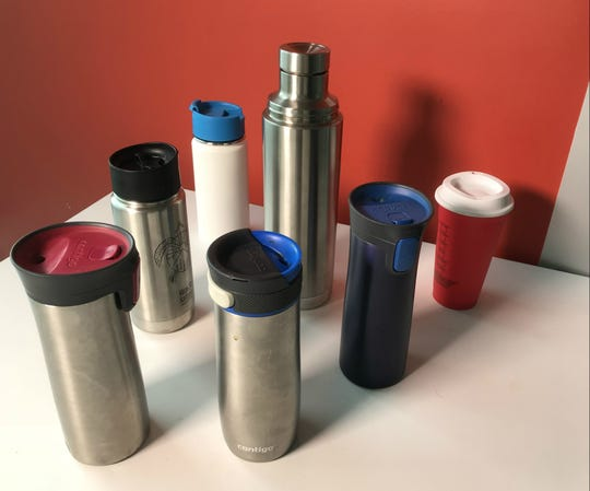 An array of re-usable hot beverage take-out vessels is on display at the Burlington Free Press on Monday, Nov. 5, 2018.