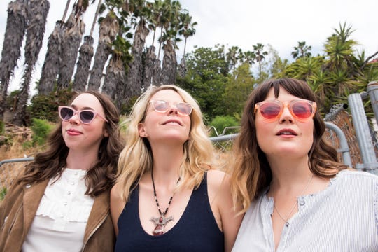 "A song inspired by Interstate 89 was ""the most collaborative song on the record,"" according to Aoife O'Donovan (center), shown with Sarah Jarosz (left) and Sara Watkins."