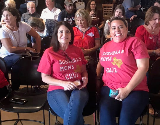 "Melissa Milner, left, and Polly Holmes wait for ⁦@tedcruz⁩ to arrive for a last-day rally on Nov. 5, 2018,  near Houston. Their shirts say ""suburban moms for Cruz"" because not all suburban moms are Democrats."""