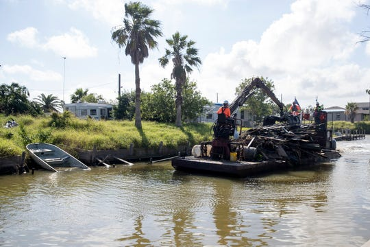 Removal of the last remaining amounts of hazardous debris from waters in Copano Cove and Copano Ridge and select portions of Salt Lake deposited by Hurricane Harvey began Monday, November 5, 2018 by Aransas County. Some items that could be found in the waterways include automobiles, trucks, motorcycles and similar vehicles; sunken and submerged vessels; large appliances such as washing machines, dryers, dish-washing machines, refrigerators, hot water heaters, and similar household appliances or commercial machine items of comparable cubic dimensions; sunken, submerged, and partially collapsed structures, decks, docks, balconies, and similar man-made structures.