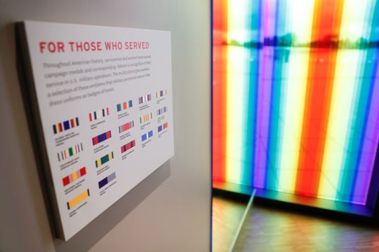 A military ribbon display and associated legend of symbols is located on the upper floor during a limited media availability at the National Veterans Memorial and Museum, Monday, Oct. 15, 2018, in Columbus, Ohio.