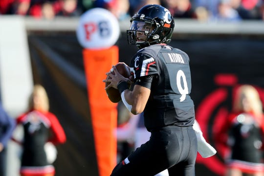 Cincinnati Bearcats quarterback Desmond Ridder (9) drops back to pass in the first quarter during a college football game between the Navy Midshipmen and the Cincinnati Bearcats, Saturday, Nov. 3, 2018, at Nippert Stadium in Cincinnati.