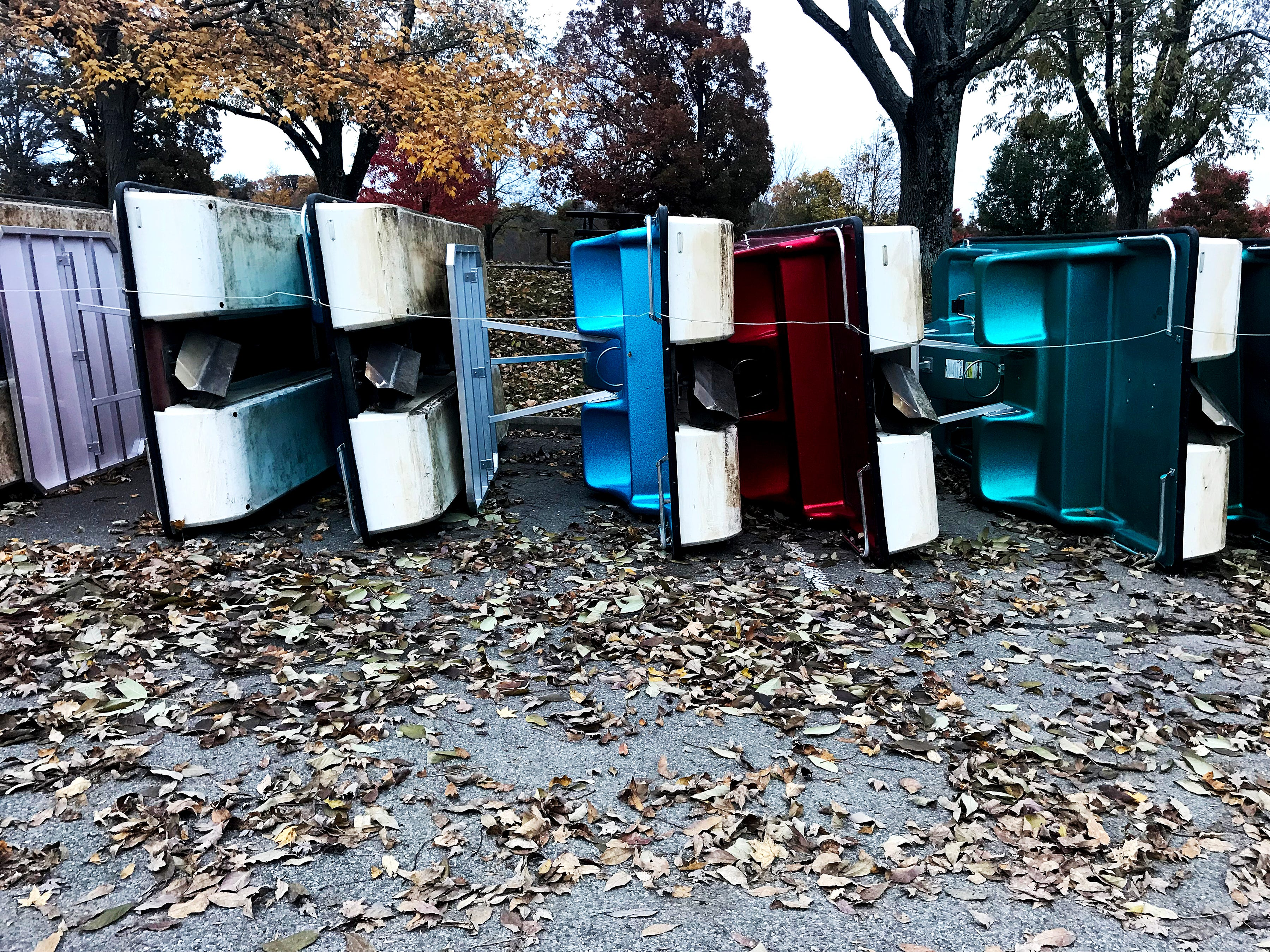 Paddleboats are stored for the fall and winter seasons at Winton Woods Park Sunday, November 4, 2018.