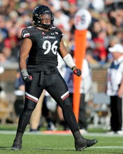 Cincinnati Bearcats defensive tackle Cortez Broughton (96) celebrates a sack in the second quarter during a college football game between the Navy Midshipmen and the Cincinnati Bearcats, Saturday, Nov. 3, 2018, at Nippert Stadium in Cincinnati.