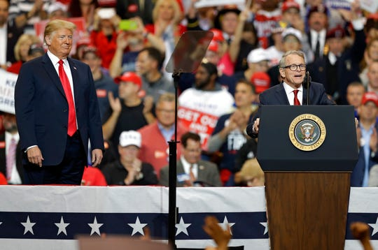 President Donald Trump, listens, as Ohio gubernatorial candidate Mike DeWine speaks at a campaign rally, Monday, Nov. 5, 2018, in Cleveland. (AP Photo/Tony Dejak)