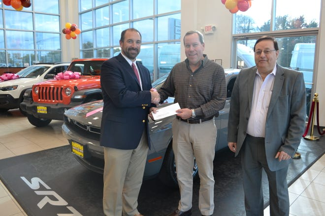 Bill McDonagh, principal of Route 18 Chrysler, Jeep, Dodge, Ram on Route 18 in East Brunswick, presents a check in the amount of $6,300 to Michael Loch, director of fund development at Carrier Clinic, in support of suicide prevention programs at New Jersey's largest behavioral health and addiction service, as Steve Simon, director of business development at Route 18 Auto, looks on.