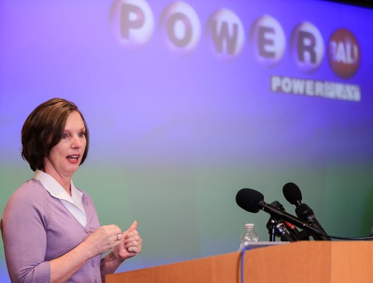 Lerynne West steps forward to claim a $343.9 million Powerball jackpot, the largest prize in Iowa history, Monday, Nov. 5, 2018.