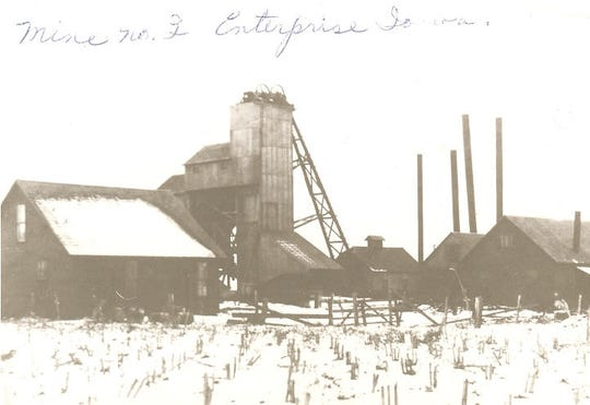 This photo shows the exterior of Enterprise No. 2, a mine east of Ankeny that opened in 1907 and closed in 1917.