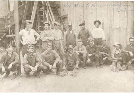 Workers at Enterprise No. 1 pose for a photo. The mine opened in 1903 and ran until 1917.