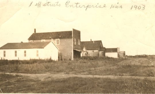 Buildings sit along a street in Enterprise, Iowa, in 1903. The small mining village of about 800 people was a planned community with a hotel, church, post office, barber shop and more.