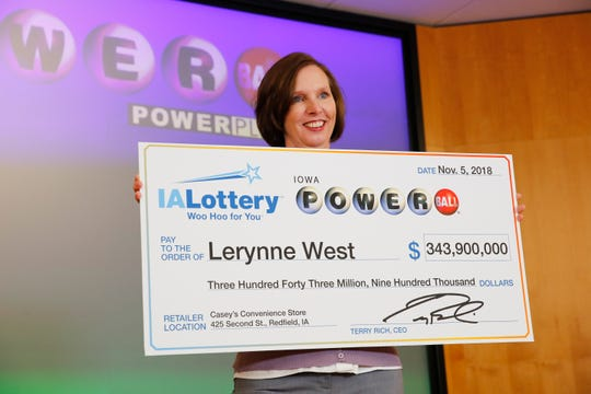 Lerynne West steps forward to claim a $343.9 million Powerball jackpot, the largest prize in Iowa history Monday, Nov. 5, 2018.