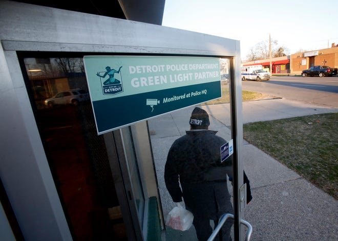A customer walks out of Southern Smokehouse on West McNichols Road in Detroit on Thursday, April 19, 2018.The carry-out BBQ restaurant participates in the Detroit Police Green Light program.
