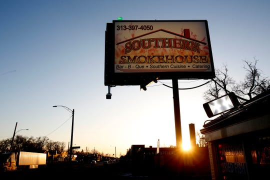 A green strobe flashes on top of a sign as the sun starts to set behind Southern Smokehouse on West McNichols  Road in Detroit, Michigan on Thursday, April 19, 2018.