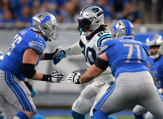 Lions guard T.J. Lang, left, in 2017.
