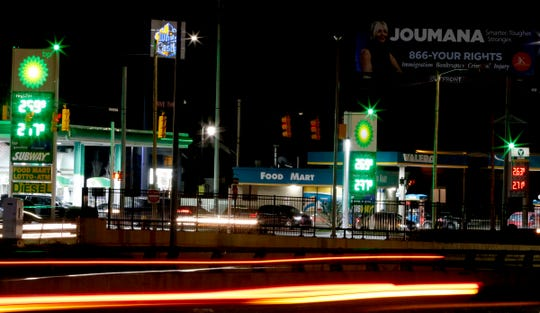 A time exposure shows green lights glowing on top of three gas stations at Grand River Avenue and Southfield Freeway in Detroit as part of the Detroit Police Green Light program on Thursday, April 19, 2018.
