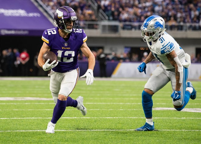 Vikings receiver Chad Beebe runs with the ball in the first quarter with Lions cornerback Teez Tabor in pursuit on Sunday.