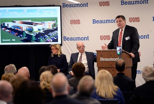 John Fox, president and CEO of Beaumont Health, unveils a rendering of the new mental health facility during the press conference.