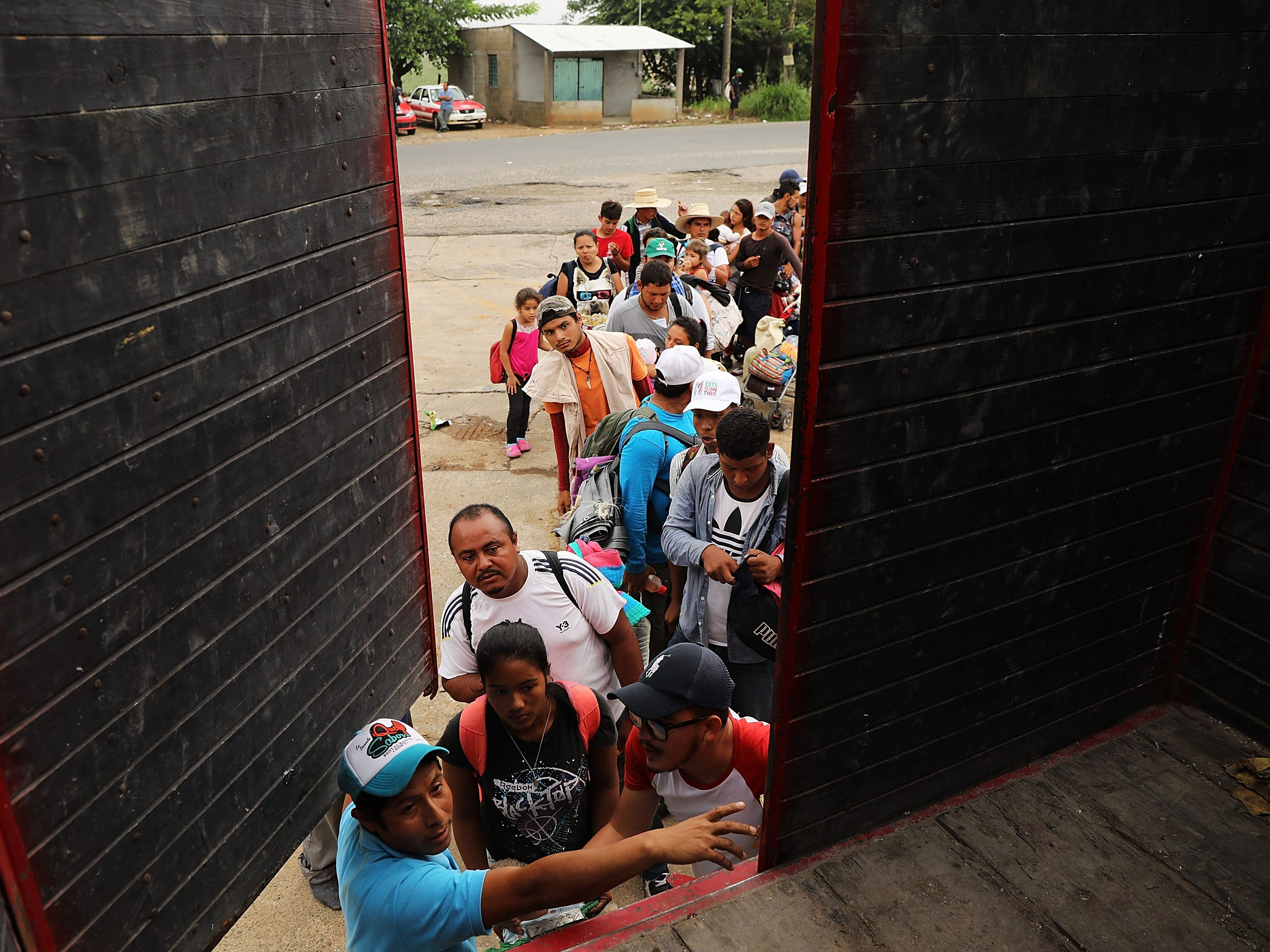 Dozens of Central American migrants  move in the early hours toward their next destination on Nov. 4, 2018, in Isla, Mexico. The migrants, many of them fleeing violence in their home countries, last took a rest day on Wednesday and have resumed their march to the United States border.