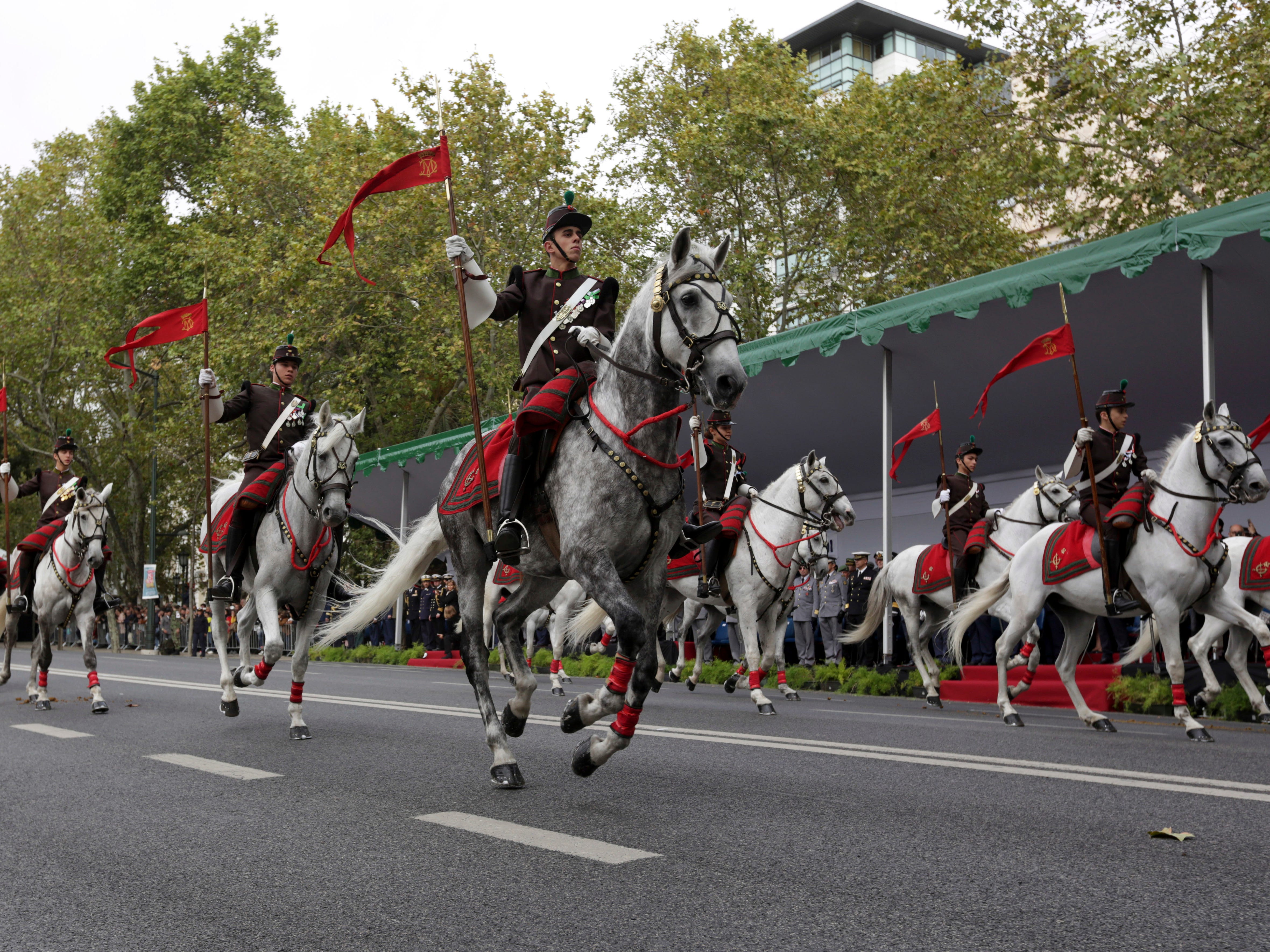 Students of the Portuguese Army School ride in a military parade in Lisbon to commemorate the centenary of the end of World War I, Sunday, Nov. 4, 2018.