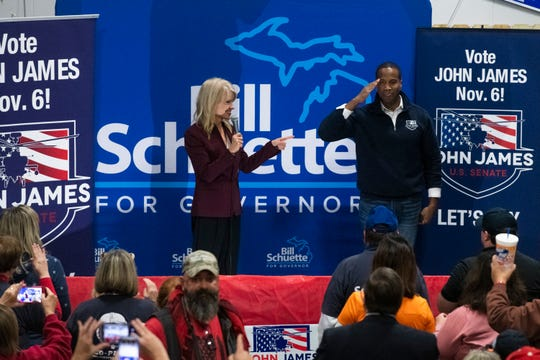 Counselor to the president Kellyanne Conway looks to Republican U.S. Senate nominee John James as he salutes the audience during a Michigan Republican Party Get Out the Vote Rally on Sunday, Nov. 4, 2018 at Top Gun Shooting Sports Inc. in Taylor.