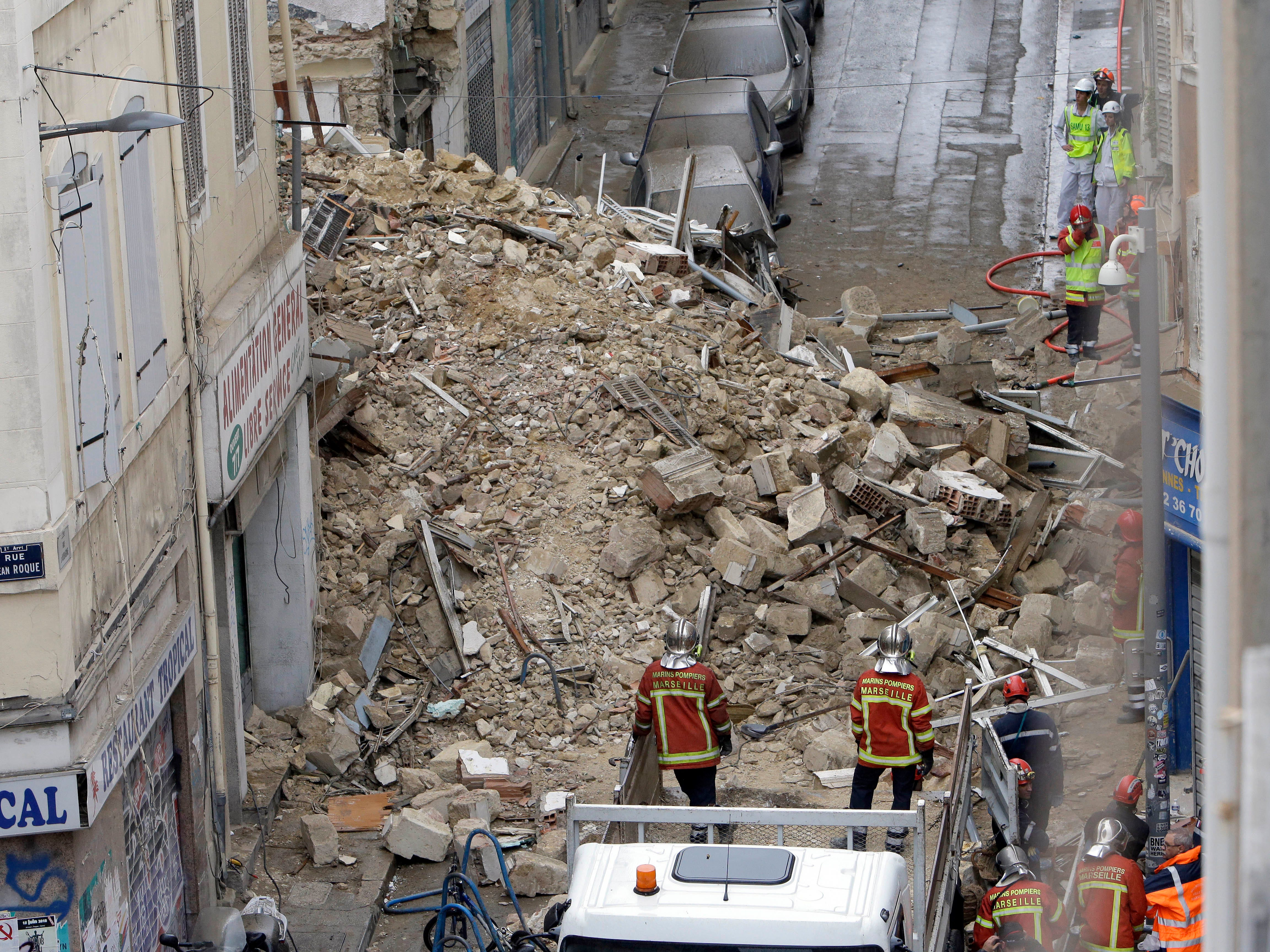 Firefighters work at the scene where buildings collapsed in Marseille, southern France, Monday, Nov. 5, 2018.