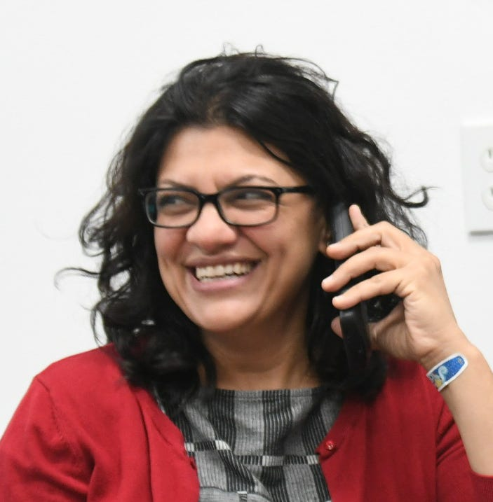 Former state Rep. Rashida Tlaib, left, and current state Rep. Stephanie Chang make phone calls at a phone bank for millennial volunteers in Detroit on Nov. 5, 2018.