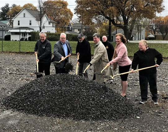 Representatives from the Twin Tier Horseshoe League and local officials hold a ceremonial groundbreaking Monday for a new championship horseshoe court at McKinnon Park in Elmira.