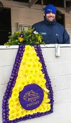 Ellis Park champion Brad Cox holds Breeders' Cup Distaff blanket.