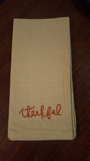 "Nick Mueller custom-embroiders items from blankets, to patches to napkins for   his business Sew Right, LLC. Pictured is a napkin, which reads ""Thankful."""