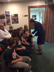 Congresswoman Marcy Kaptur meets with students at a school board meeting.