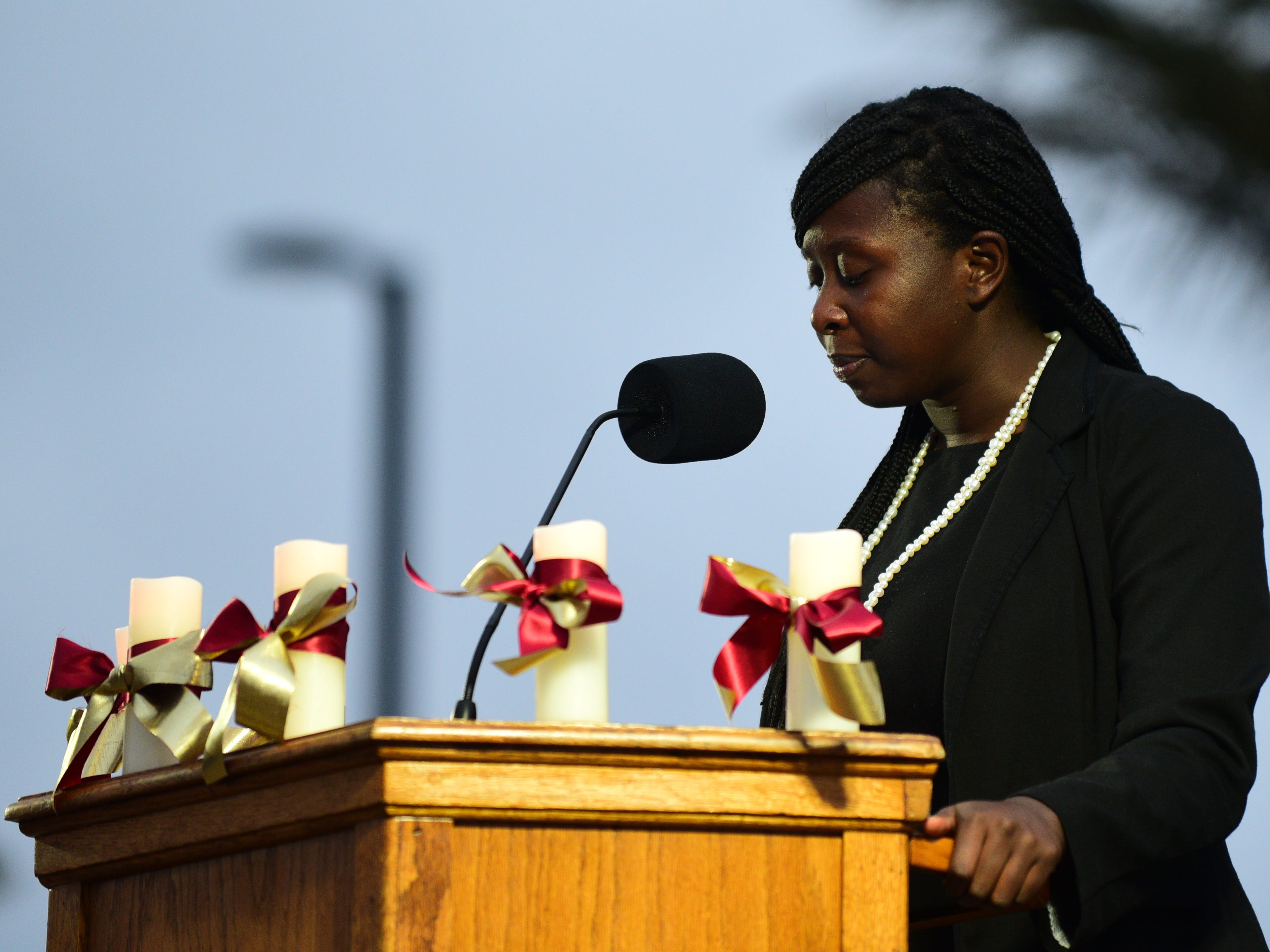 Stacey Pierre, student president of the Florida State  University Student Body, holds back tears as she speaks at a vigil at Langford Green on Sunday.