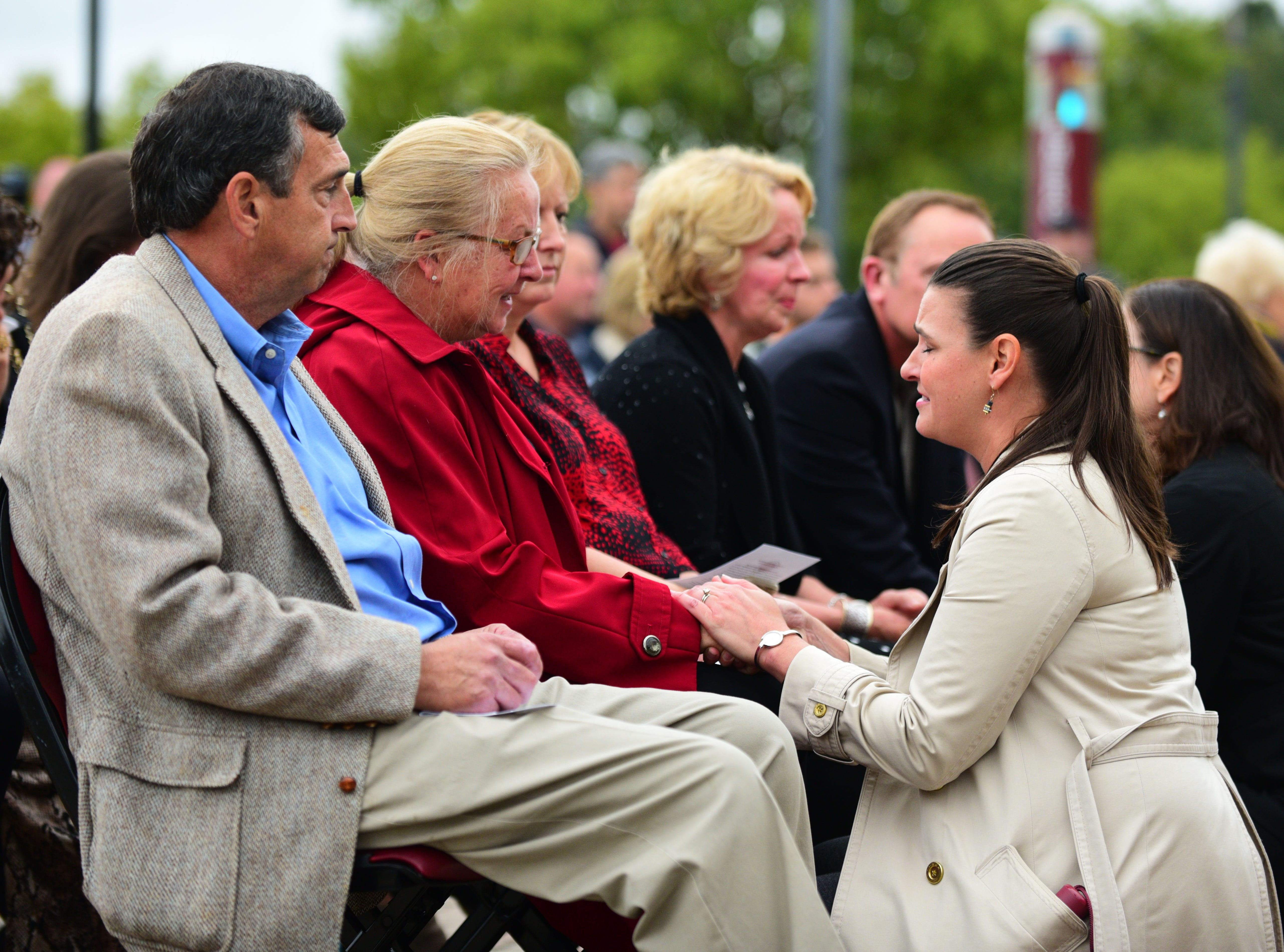 Florida State University faculty members comfort the grieving families of Maura Binkley and Dr. Nancy Van Vessem at a vigil at Langford Green on Sunday.