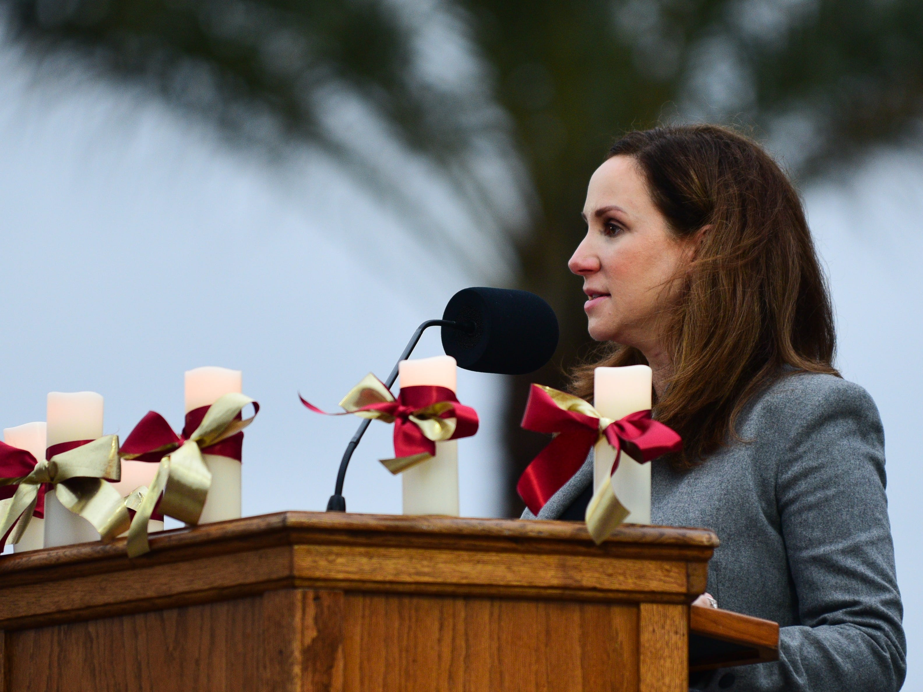Dr. Amy Hect, Vice President of Florida State University Student Affairs, speaks to a grieving FSU community at Langford Green on Sunday.