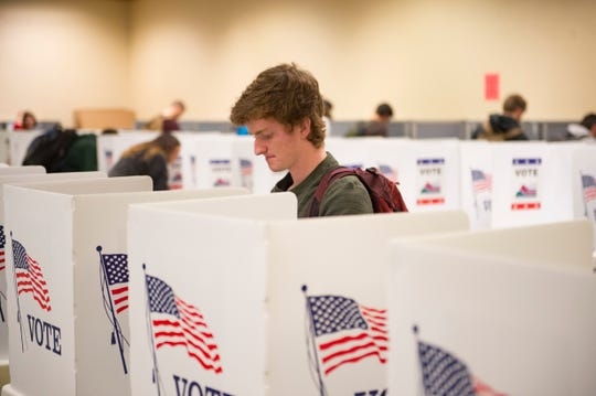 Charlie Bucklar casts his vote during early voting at CSU's Lory Student Center on Monday, November 5, 2018. Election judges said a steady stream of students were turning out to vote the day before Election Day.