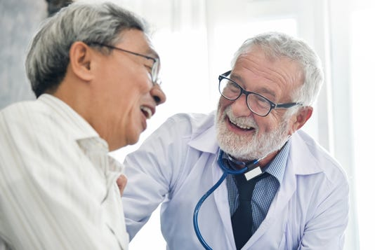 Happiness Of Senior Male Doctor With Asian Male Patient