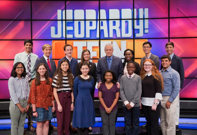 """Jeopardy!"" host Alex Trebek and the teens competing on the show's 2018 ""Teen Tournament"""