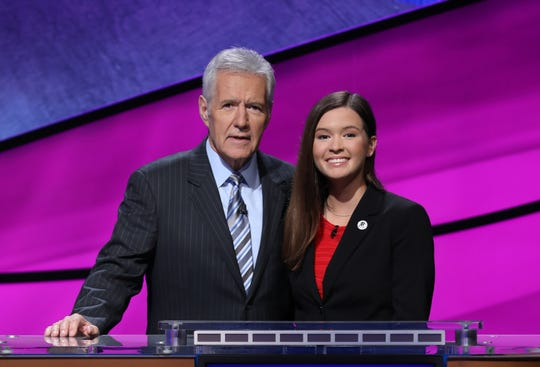 "Bonita Springs teen Claire Sattler and ""Jeopardy!"" host Alex Trebek pose for a photo during the August 2018 taping of the ""Teen Tournament."""
