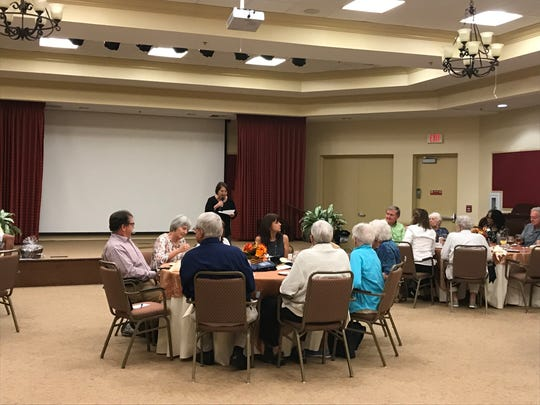 Gloria Tate speaks at a preview event at Gulf Coast Village for an upcoming short film about Cape Coral.
