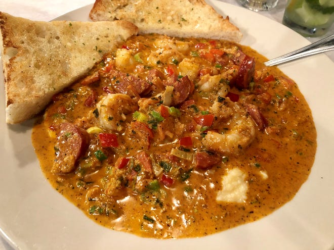 Salty Papa's crafts its shrimp and grits with fresh-from-the-boat Gulf pink shrimp and andouille in a rich, spicy broth.