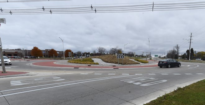 A southbound vehicle, at left, meets traffic going north on State 42 at the Michigan Street roundabout in Sturgeon Bay.