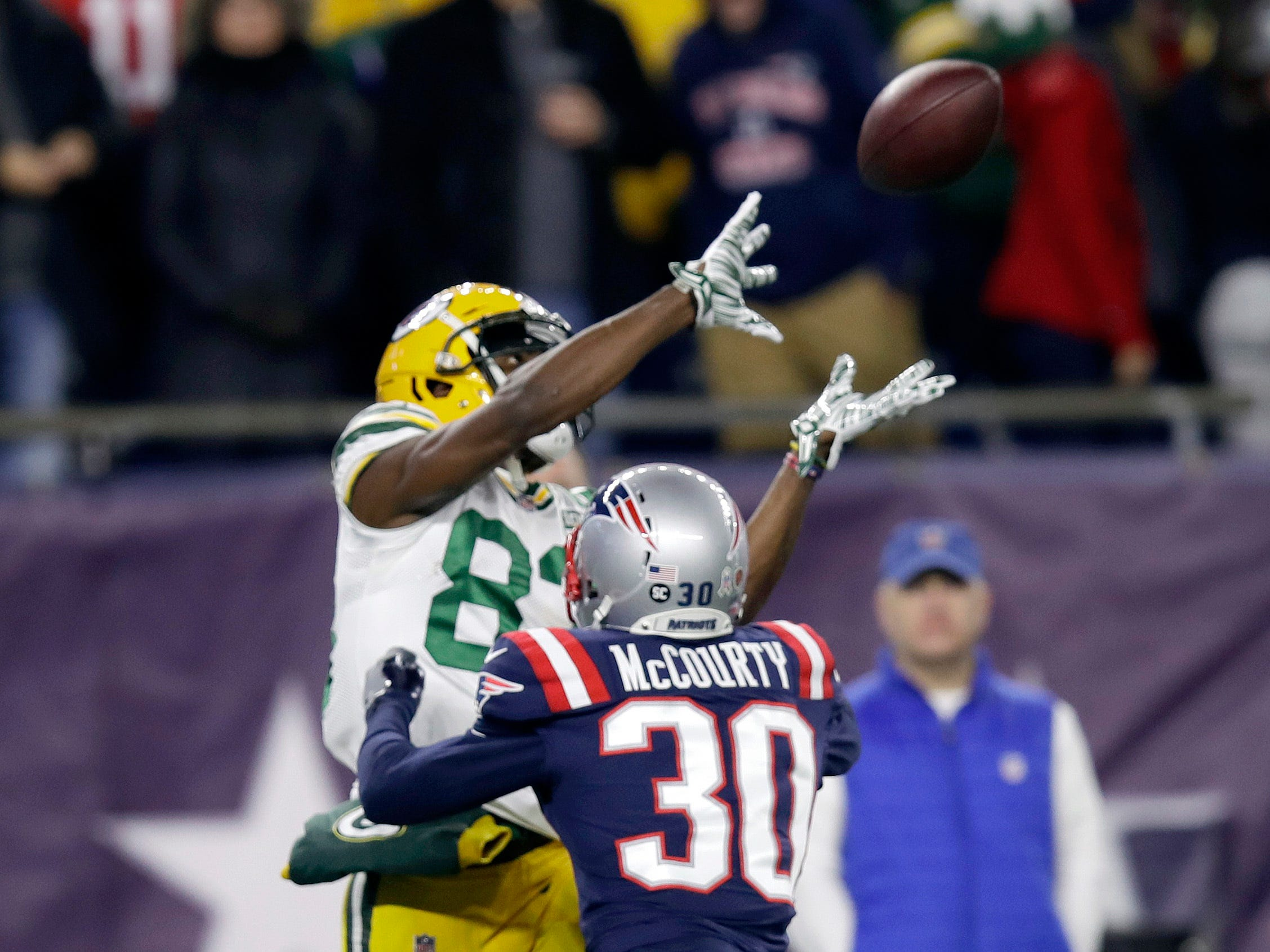 New England Patriots defensive back Jason McCourty (30) breaks up a pass intended for Green Bay Packers wide receiver Marquez Valdes-Scantling during the first half of an NFL football game, Sunday, Nov. 4, 2018, in Foxborough, Mass. (AP Photo/Charles Krupa)