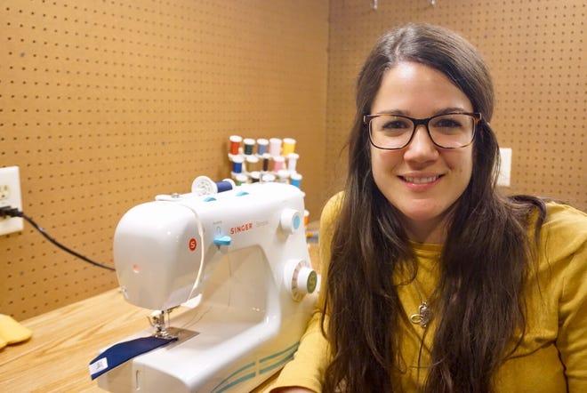 Grace Menocal of De Pere makes baby booties for her business, jamBam! booties.