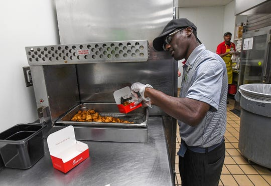 Latorre Brooks said he enjoys cooking fries and chicken nuggets as part of his job at the Chick-fil-A at Greenville Memorial Hospital.