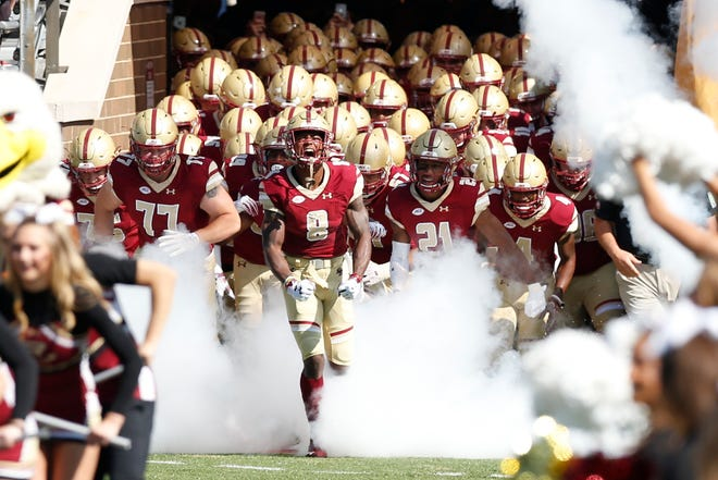 Sep 29, 2018; Chestnut Hill, MA, USA; Boston College Eagles defensive back Will Harris (8) leads the team on to the field before the game against the Temple Owls at Alumni Stadium. Mandatory Credit: Greg M. Cooper-USA TODAY Sports