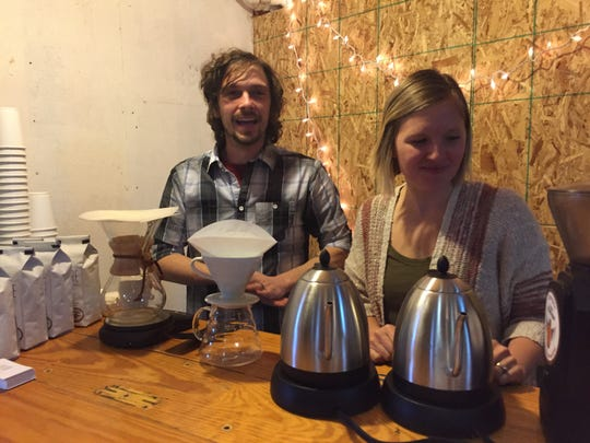 Andy and Anna Pollard poured samples of their Folklore Coffee at a sneak peek for Cut Bank Creek Brewery, which recently brewed a Folklore Coffee Stout.