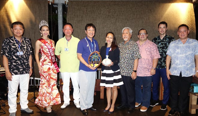 Toi Hotel Cooperative Chairman Takato Noge, Miss Asia Pacific International Guam 2018 Cyndal Abad, Toi Branch of Izu City Tourism Association Branch Chief Kazuyuki Goto, Izu City Mayor Yutaka Kikuchi, Senator Regine Biscoe Lee, GVB Board Chairman Milton Morinaga, Puntan Dos Amantes President Leonard Calvo, GVB President and CEO Nathan Denight, and GVB Japan Marketing Committee Chairman Bill Nault take a group photo during a gift exchange between Guam and Japan delegations at Terraza at Dos Amantes.