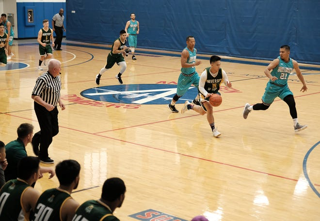 In this undated photo from regular season play, the University of Guam Tritons men's basketball team competes against the Bulldogs team in a Bombers Basketball League game at Andersen Air Force Base.